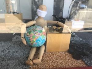 Art figure wearing a mask, Buttons shop, Newtown